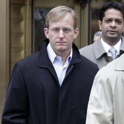 Joseph Skowron III, , left, of Greenwich, Connecticut, leaves Federal Court, in New York,  Wednesday, April 13, 2011. The Ivy League-trained physician who became a health care investment analyst surrendered Wednesday on charges that accuse him of evading $30 million in losses for a hedge fund by obtaining confidential information from a French doctor about clinical liver disease drug trials.