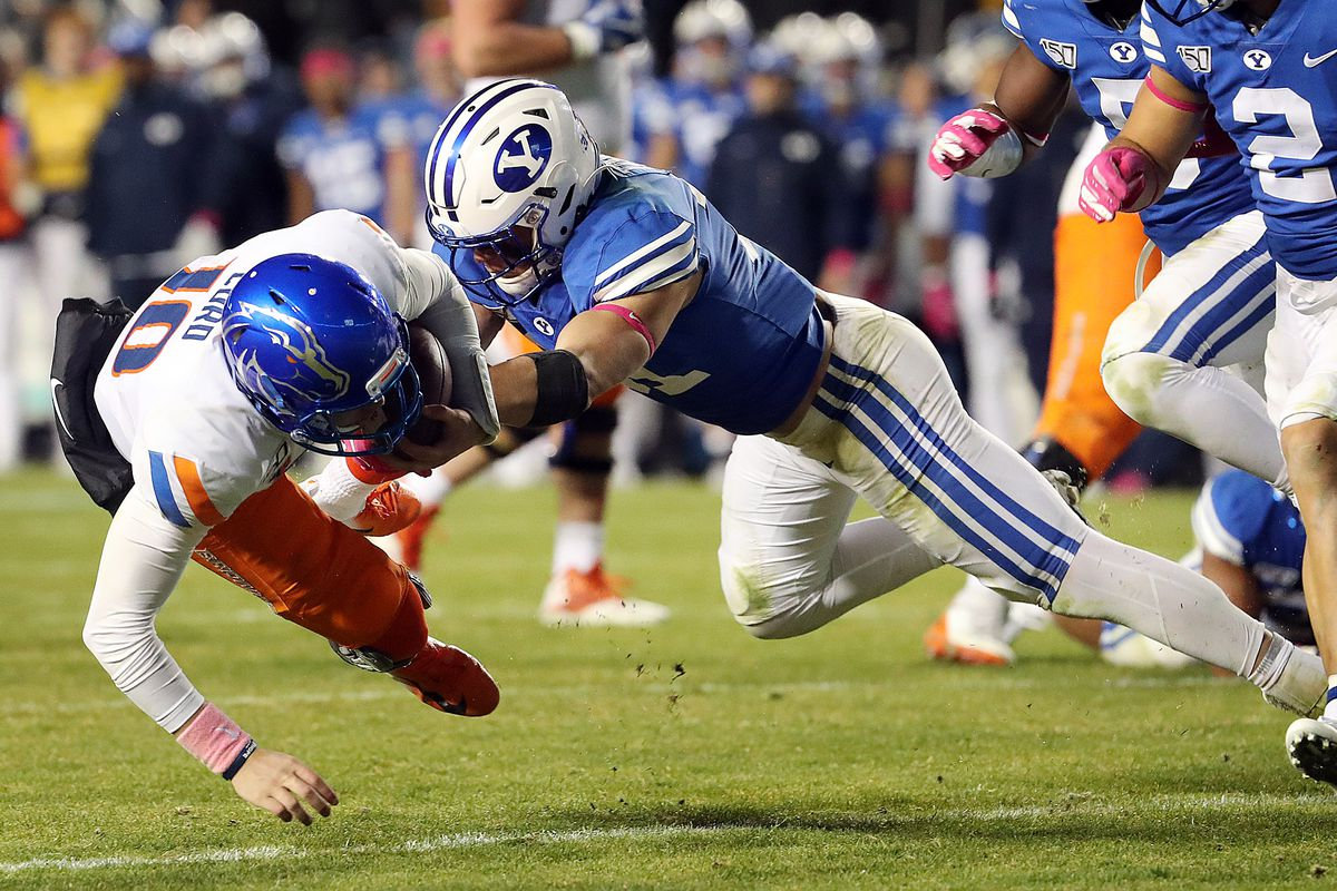 Boise State Broncos quarterback Chase Cord is tackled by Brigham Young Cougars linebacker Max Tooley during NCAA football in Provo on Saturday, Oct. 19, 2019.