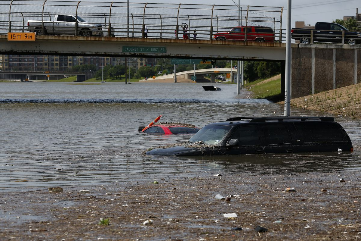 Vehicles are left stranded on Texas State Highway 288 in Houston, Texas on May 26, 2015.