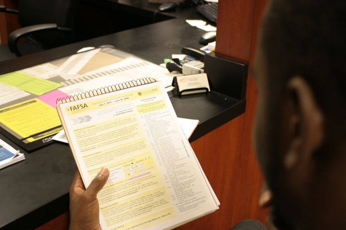 Student looking at a FAFSA information sheet