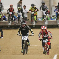 Connor Clifford, 6, right, practices prior to racing BMX in South Jordan Dec. 6, 2015.