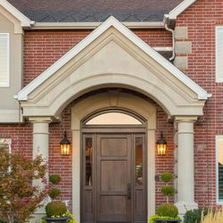 After: Upgrading the front door can enhance curb appeal and energy efficiency.