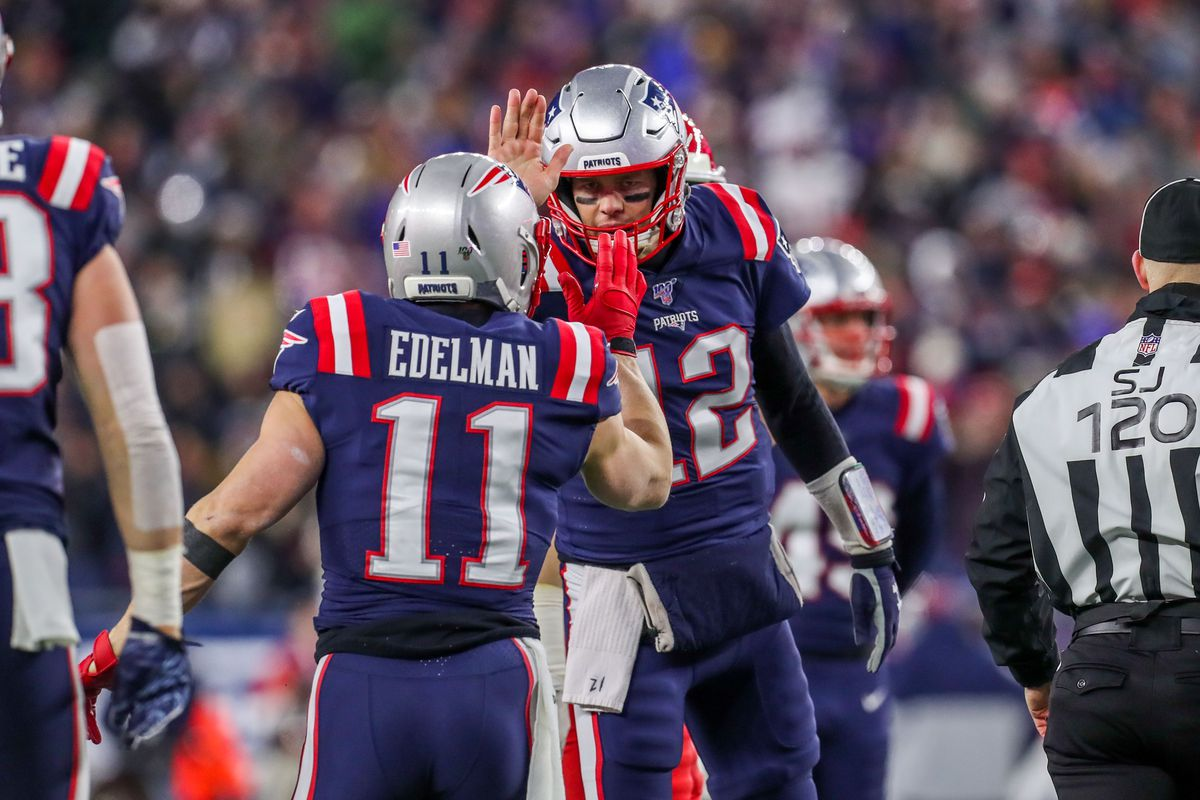 New England Patriots quarterback Tom Brady and New England Patriots receiver Julian Edelman celebrate after a touchdown during the first half against the Kansas City Chiefs at Gillette Stadium.