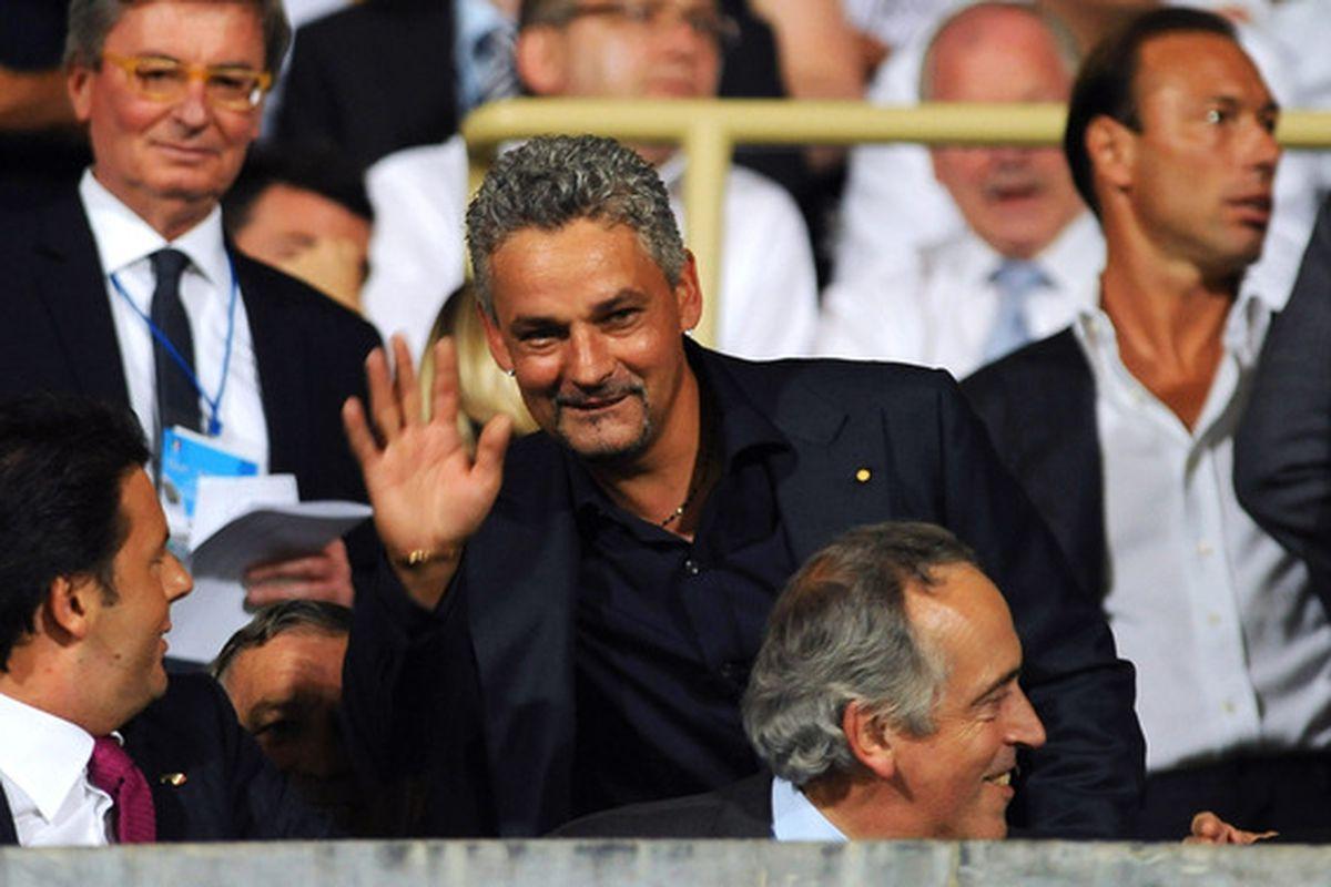 Former Inter player Roberto Baggio waves hello