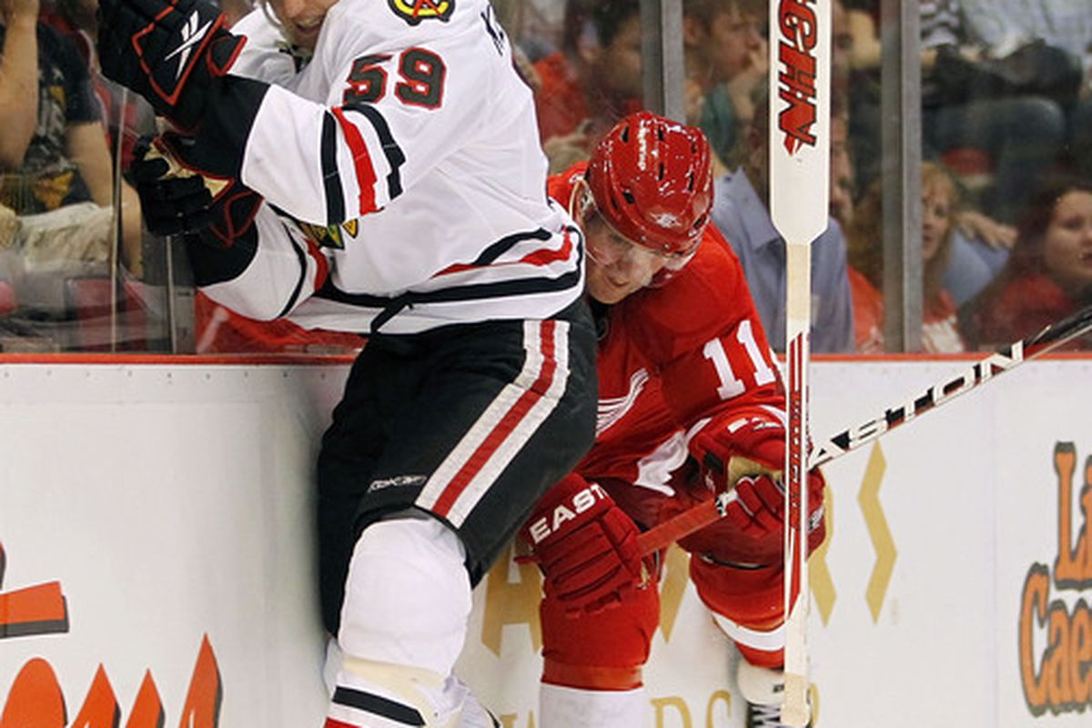 Featured: Rob Klinkhammer with the Blackhawks, Dan Cleary, and a floating goalie stick they are both anxiously trying to avoid.  (Photo by Gregory Shamus/Getty Images)