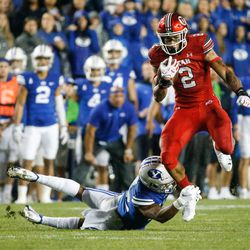 Utah Utes running back Micah Bernard (2) gets pressured by Brigham Young Cougars defensive back Malik Moore during the second half of an NCAA college football gameat LaVell Edwards Stadium in Provo on Saturday, Sept. 11, 2021. BYU won 26-17.