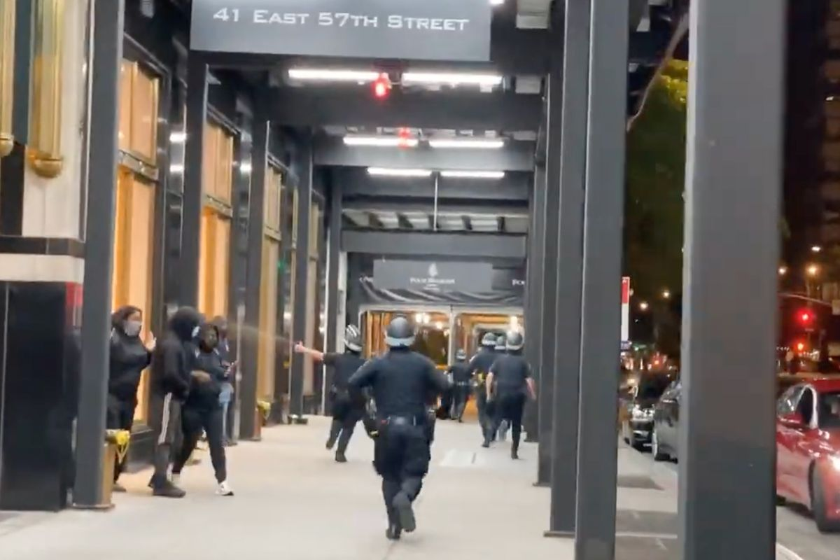 The NYPD released video of an officer pepper spraying a bystander in Midtown during a protest on June 1, 2020.