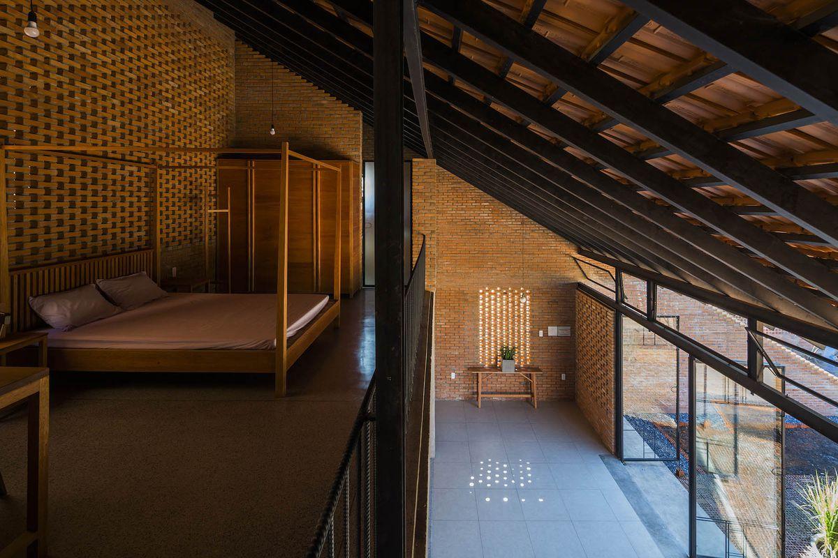 Interior of brick house with light pattern on floor