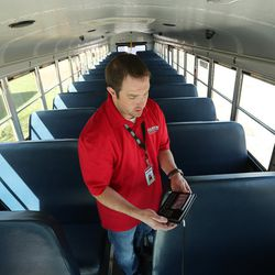 Shaun Adams, systems specialist with Alpine School District, diagnoses camera operation on a school bus in American Fork on Friday, March 17, 2017. Alpine School District has added monitors and cameras on its buses to create a safe bus culture to help with bullying.