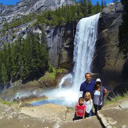 Greg Trimble, his wife Kristyn and their two children visit a scenic waterfall.