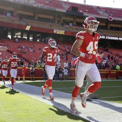 Kansas City Chiefs players defensive back Daniel Sorensen (49) and defensive back D.J. White (24) warm up before an NFL football game in Kansas City, Mo., Sunday, Oct. 23, 2016.