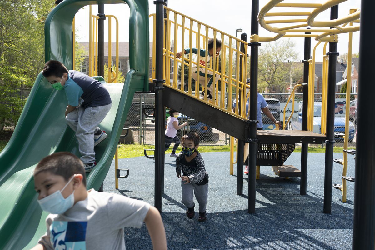 Children playing on a playground in Chicago.