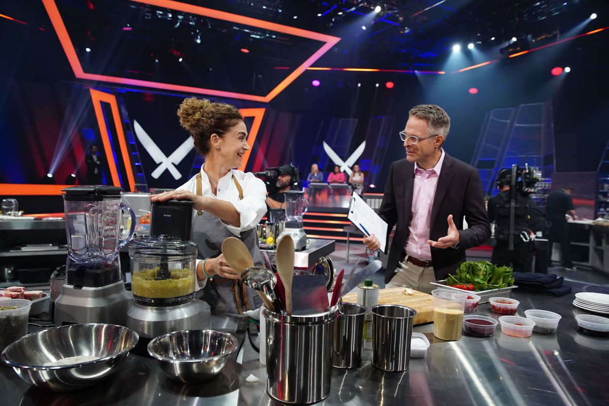 Chef Fisun Ercan and critic Chris Nuttall-Smith on Iron Chef Canada's set.