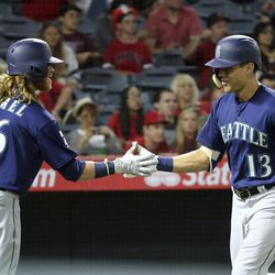 Seattle Mariners' Jacob Hannemann (13) is congratulated by Ben Gamel on his home run against the Los Angeles Angels in the fifth inning of a baseball game in Anaheim, Calif., Saturday, Sept. 30, 2017. Hannemann played baseball at BYU and served an LDS mission.