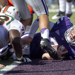 Kansas State quarterback Collin Klein (7) lands in the end zone past Miami defensive lineman Darius Smith (98) during the first half of an NCAA football game in Manhattan, Kan., Saturday, Sept. 8, 2012.