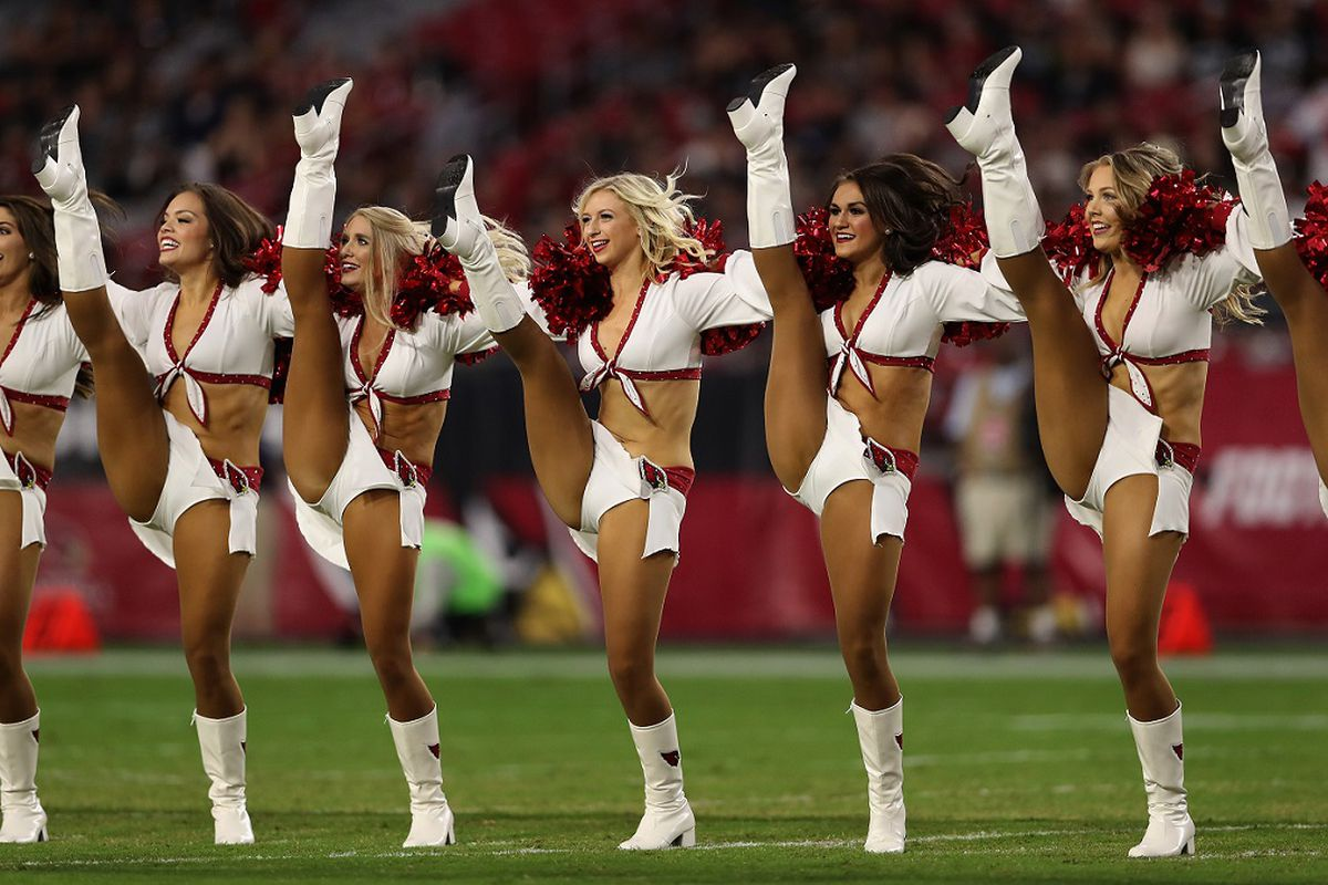 GLENDALE, AZ - AUGUST 12:  The Arizona Cardinals cheerleaders perform before the NFL game against the Oakland Raiders at the University of Phoenix Stadium on August 12, 2017 in Glendale, Arizona.  (Photo by Christian Petersen/Getty Images)