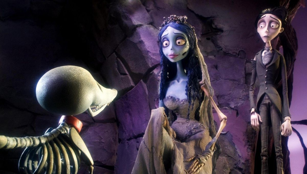 emily in corpse bride, with victor standing slightly behind her, and victor's dead skeleton dog in the forefront