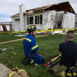 Riverdale firefighters hydrate themselves in front of a house destroyed by a tornado that struck Washington Terrace on Thursday, Sept. 22, 2016. Officials said nobody was injured in the twister.
