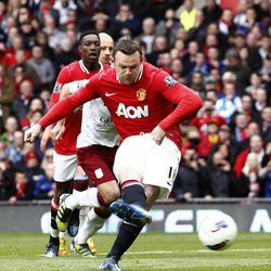 Manchester United's Wayne Rooney scores a penalty against Aston Villa during their English Premier League soccer match at Old Trafford Stadium, Manchester, England, Sunday, April 15, 2012.