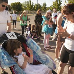 Anita Reardon claps with her daughter, JulieLynn Reardon, as they prepare for the Fairy Tale 5K with Joe Reardon at Thanksgiving Point in Lehi Saturday, June 21, 2014. In spite of being diagnosed with a severe form of epilepsy, JulieLynn Reardon is on grade level in most subjects.