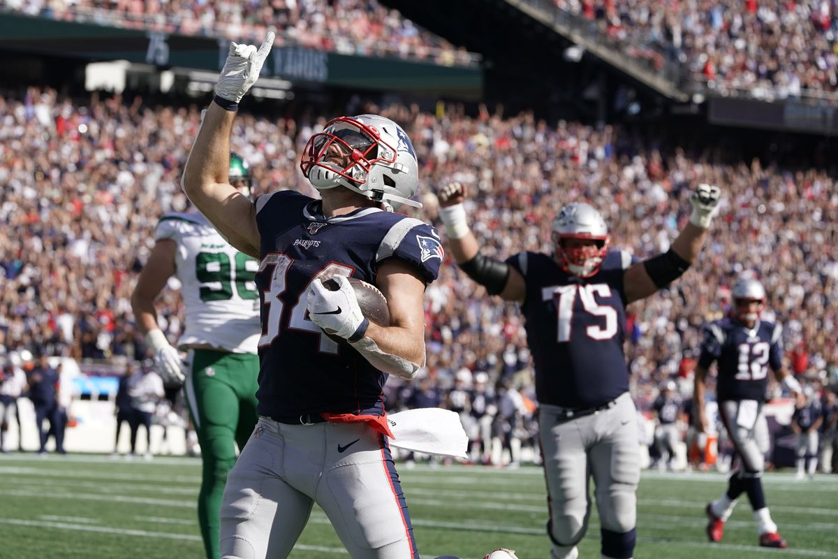 New England Patriots running back Rex Burkhead reacts after his touchdown run against the New York Jets in the third quarter at Gillette Stadium.