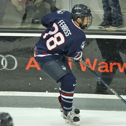 UConn's Joey Ferriss (28) brings the puck up along the boards.