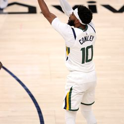 Utah Jazz guard Mike Conley (10) puts up a three point shot as the Utah Jazz and LA Clippers play in an NBA basketball game at Vivint Smart Home Arena in Salt Lake City on Friday, Jan. 1, 2021. Utah won 106-100.