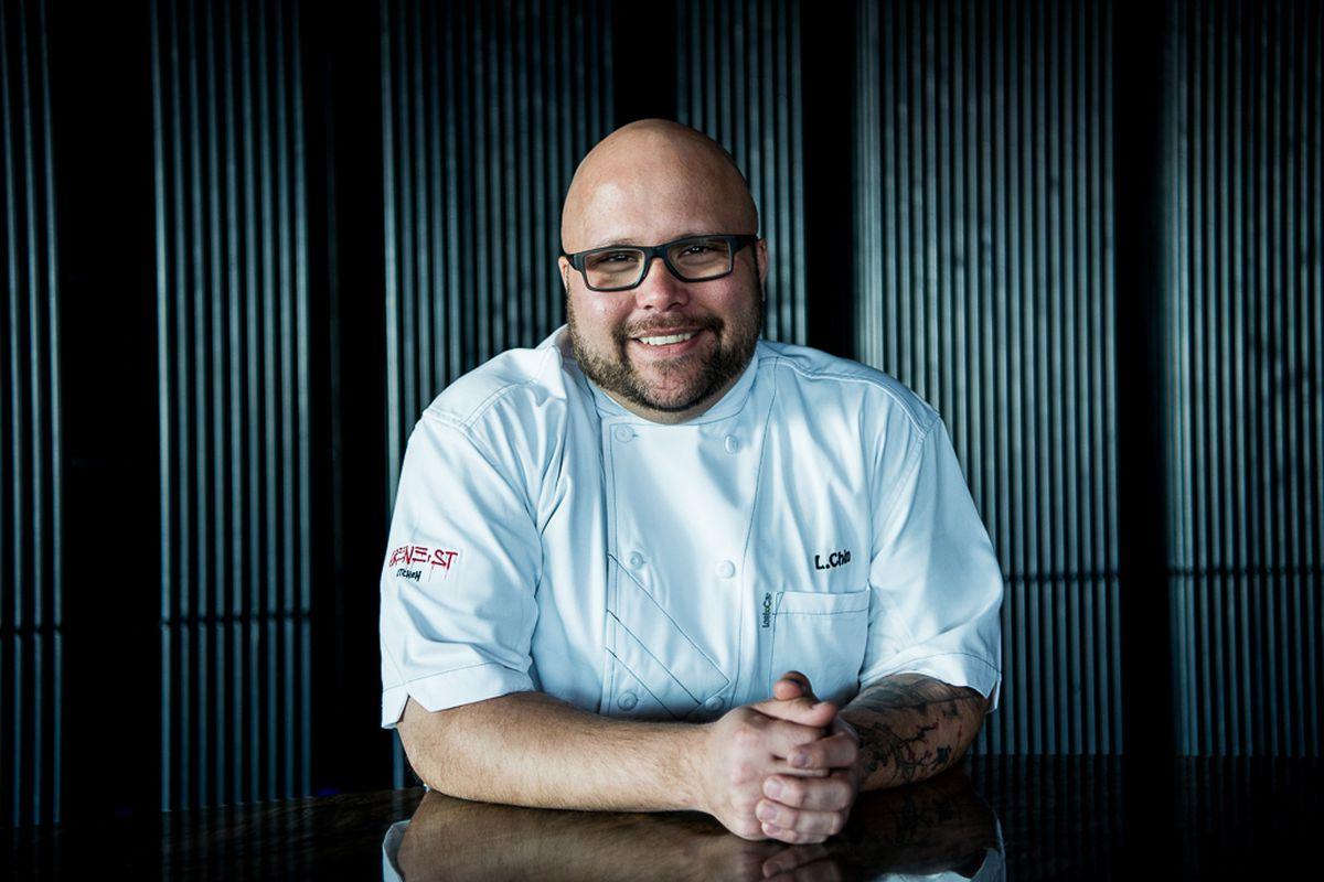 A chef leans forward