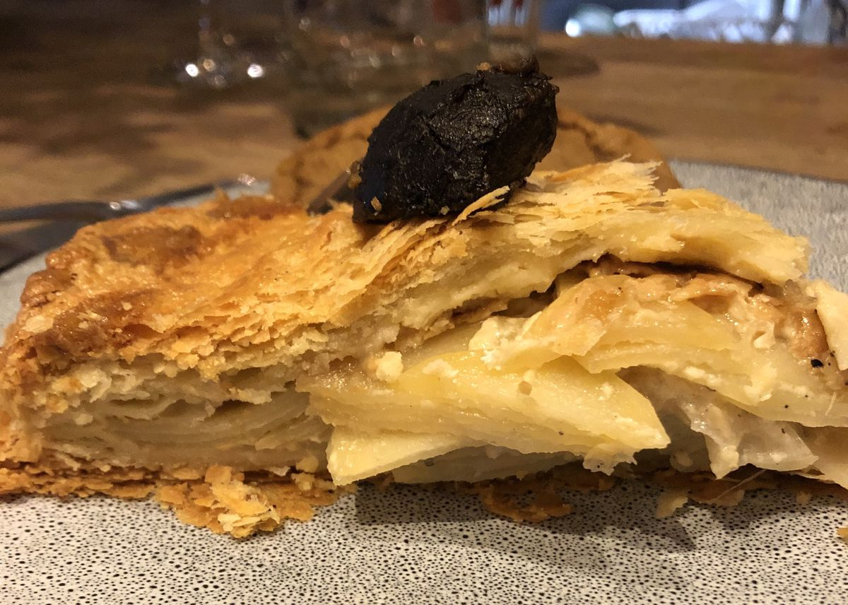 Potato dauphinoise pie, topped with a pickled walnut