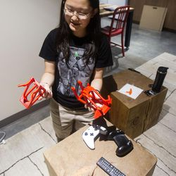 Tianxing Jin, a junior at the University of Utah, demonstrates how her gaming rack made with a 3-D printer comes apart in her loft in the Lassonde Studios on the U. campus in Salt Lake City on Friday, June 23, 2017.