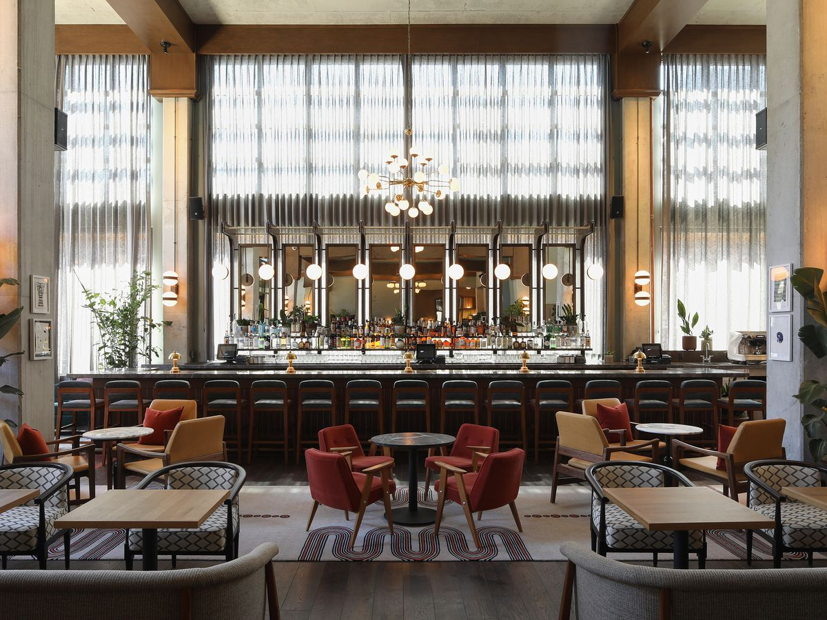A large hotel restaurant with huge windows