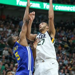 Utah Jazz center Rudy Gobert (27) shoots over Golden State Warriors forward Kevon Looney (5) during the game at Vivint Arena in Salt Lake City on Tuesday, April 10, 2018.