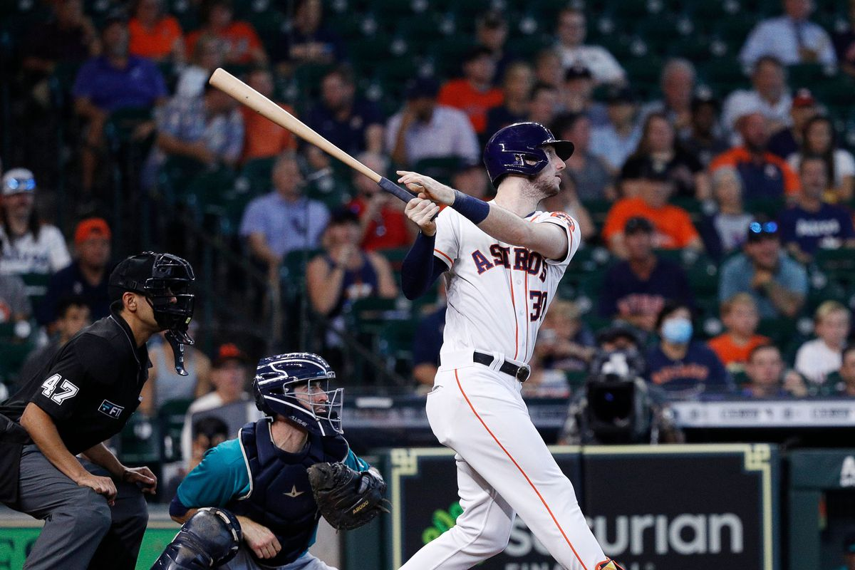 Kyle Tucker #30 of the Houston Astros doubles in Yordan Alvarez #44 in the second inning Mariners at Minute Maid Park on September 08, 2021 in Houston, Texas.