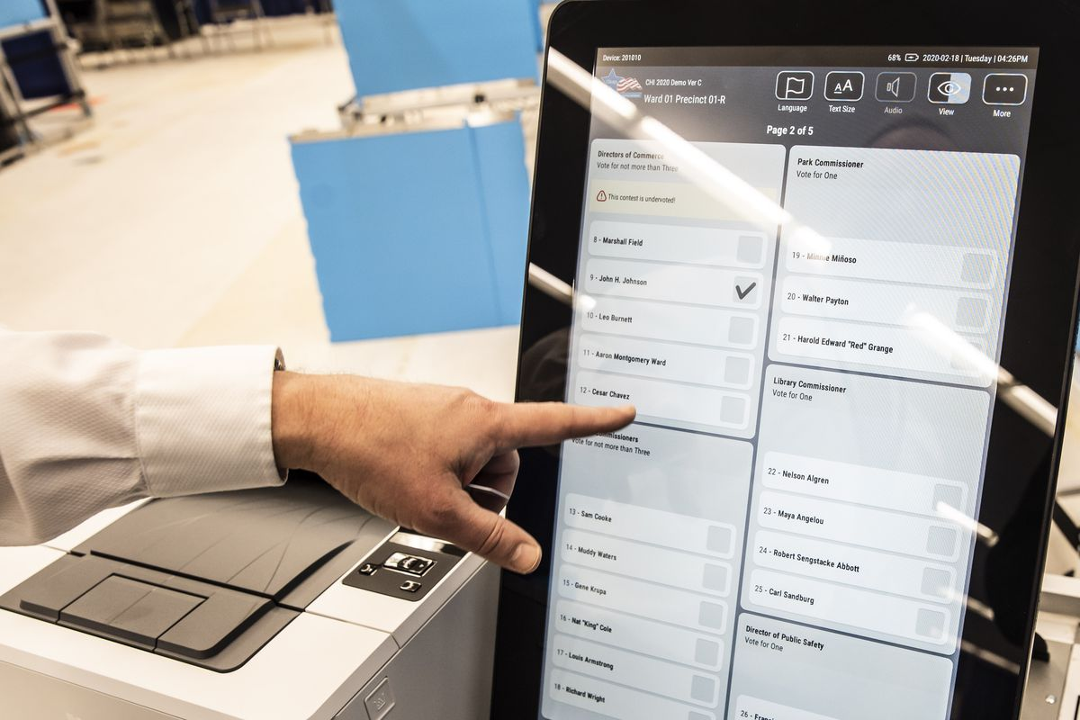 Chicago Election Board Spokesman Jim Allen uses a demonstration ballot to show off new touch screen voting machines at a Loop Super Site at 191 N. Clark. St.