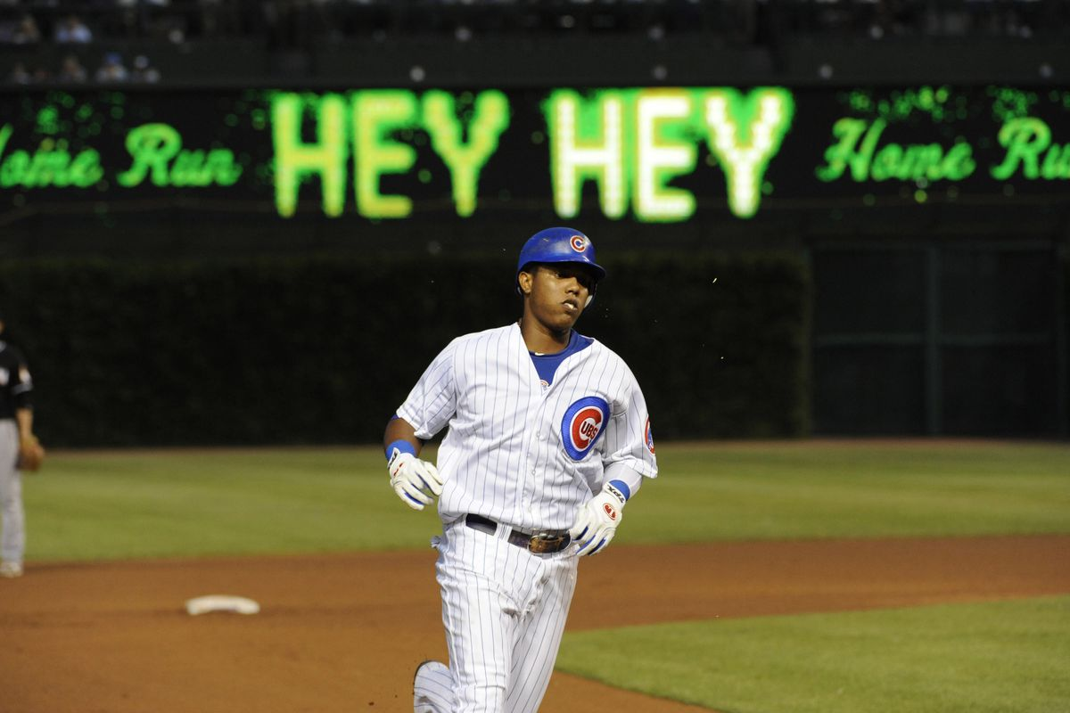 July 18, 2012; Chicago, IL, USA; Chicago Cubs shortstop Starlin Castro (13) hits a solo home run against the Miami Marlins in the fourth inning at Wrigley Field.  Mandatory Credit: David Banks-US PRESSWIRE