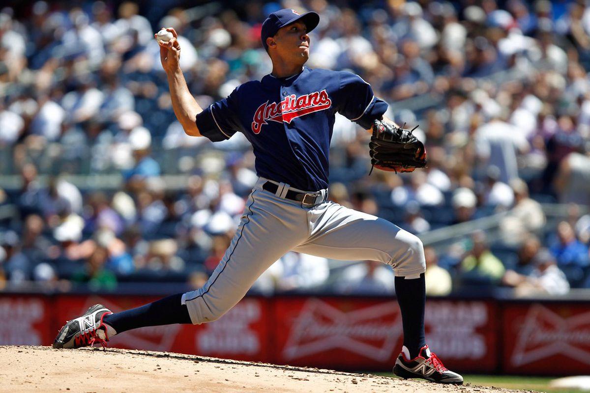 June 27, 2012; Bronx, NY, USA; Cleveland Indians starting pitcher Ubaldo Jimenez (30) pitches against the New York Yankees during the third inning at Yankee Stadium. Mandatory Credit: Debby Wong-US PRESSWIRE