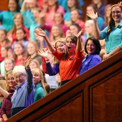 Members of the Relief Society Choir from the Provo Missionary Training Center wave to the crowd at the end of the General Relief Society meeting for The Church of Jesus Christ of Latter-day Saints at the LDS Conference Center in Salt Lake City on Saturday, Sept. 28, 2013.