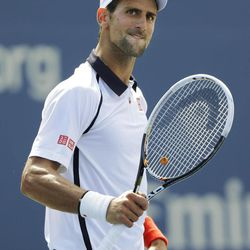 Novak Djokovic of Serbia reacts while playing Spain's David Ferrer during a semifinal match at the 2012 US Open tennis tournament,  Sunday, Sept. 9, 2012, in New York.