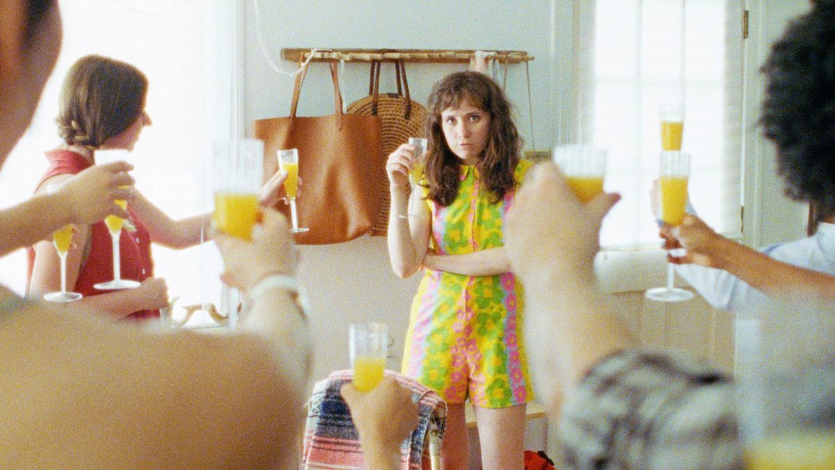 Noël Wells holding a mimosa in 'Mr. Roosevelt'