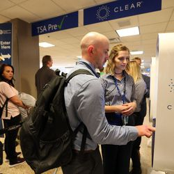 Jonathan Spurgin verifies his identity using CLEAR, a new biometric, fee-based service that allows travelers to move past manual ID verification lines using fingerprints and iris scans, at the Salt Lake City International Airport in Salt Lake City on Wednesday, July 12, 2017.