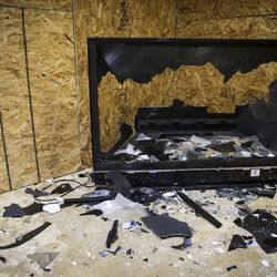 A TV sits in pieces at Tantrums in Houston on Saturday, July 15, 2017. Tantrums is a business where people can let off steam by using bats, poles, golf clubs and sledge hammers to destroy TVs, mirrors, cups, sheets of glass and more. The owner, Shawn Baker, started Tantrums after she was laid off from her job in the oil industry, and she said her business acts as therapy to some and fun for others.