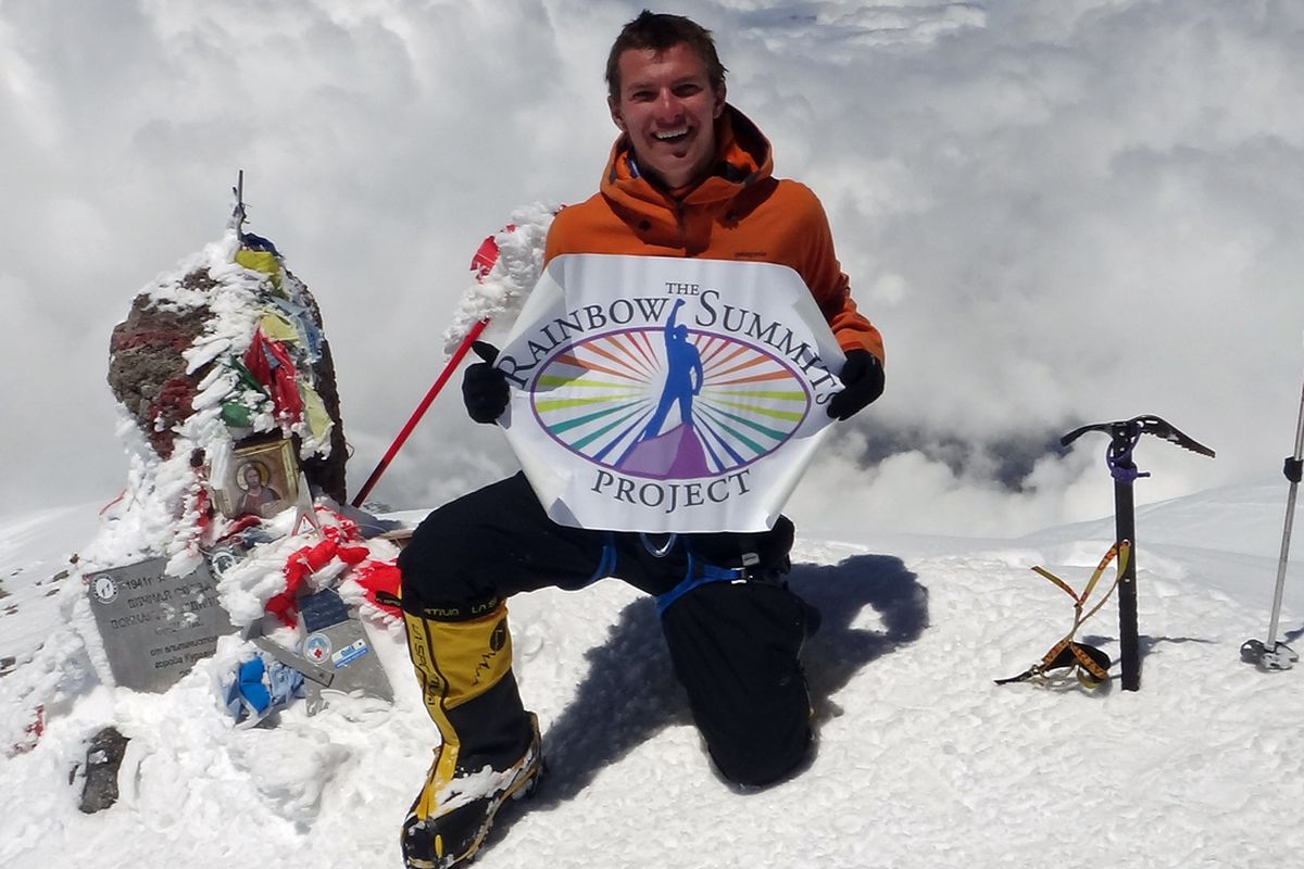 Cason Crane with Rainbow Summits poster on Mount Elbrus in Russia.