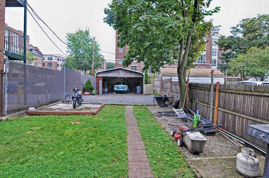 A one-car garage at the end of a long yard.
