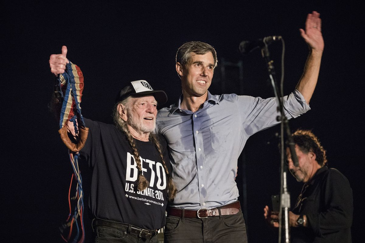 Singer-songwriter Willie Nelson and Beto O'Rourke on stage during the 'Turn Out for Texas Rally' in Austin, Texas, on September 29, 2018.