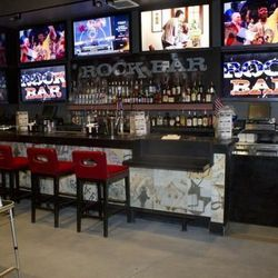 """<a href=""""http://vegas.eater.com/archives/2012/07/09/now-partying-rock-bar-is-the-temp-home-for-rockhouse.php"""">Vegas: Now Partying, <strong>Rockbar</strong> is the Temp Home for Rockhouse</a> [Chelsea McManus]"""