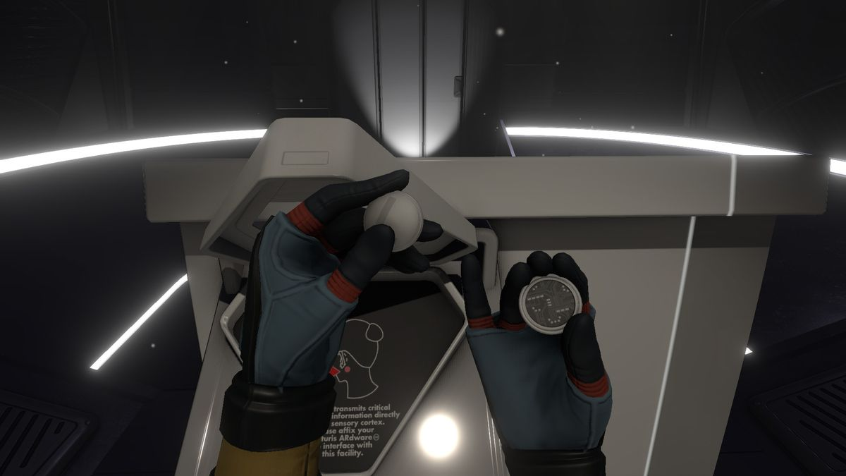 Tacoma - hands manipulating parts of a space object
