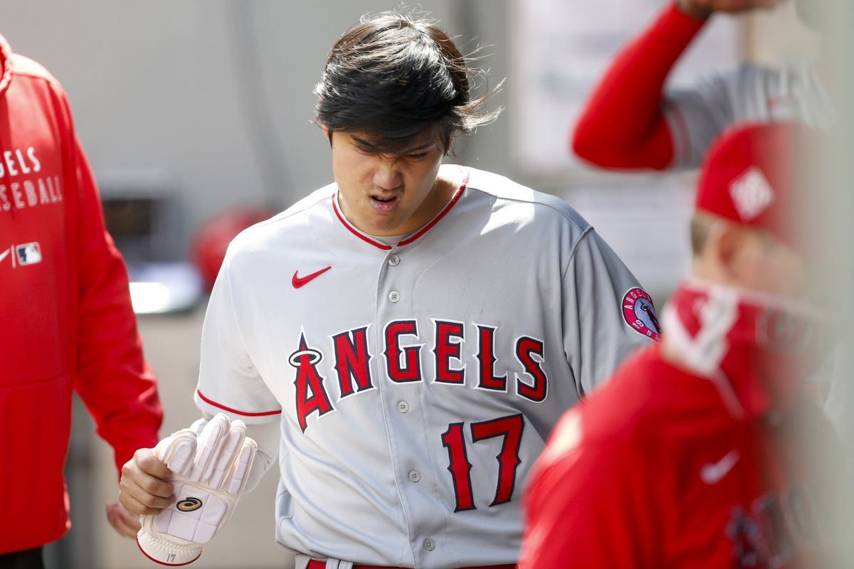Los Angeles Angels designated hitter Shohei Ohtani walks in the dugout following the first inning against the Seattle Mariners at T-Mobile Park. Ohtani was hit by a pitch during a plate appearance in the first inning.