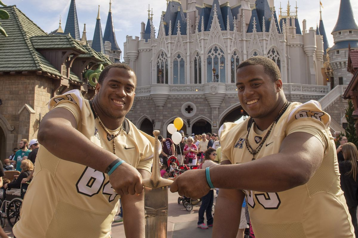 UCF Knights Football Team Honored With Gala Parade At Magic Kingdom