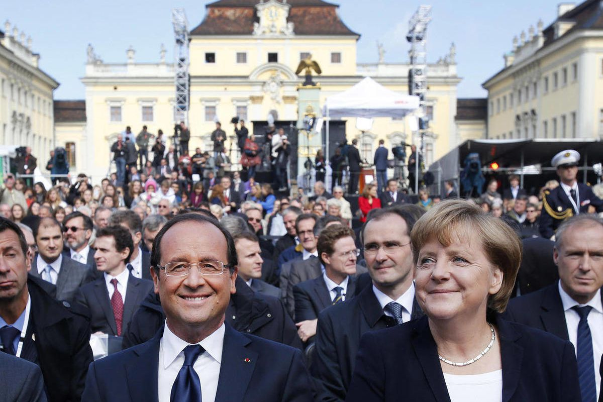 German Chancellor Angela Merkel, right, and French President Francois Hollande, at the castle in Ludwigsburg, Germany, Saturday, Sept. 22, 2012.  The leaders of France and Germany are meeting to celebrate an anniversary of their countries' reconciliation