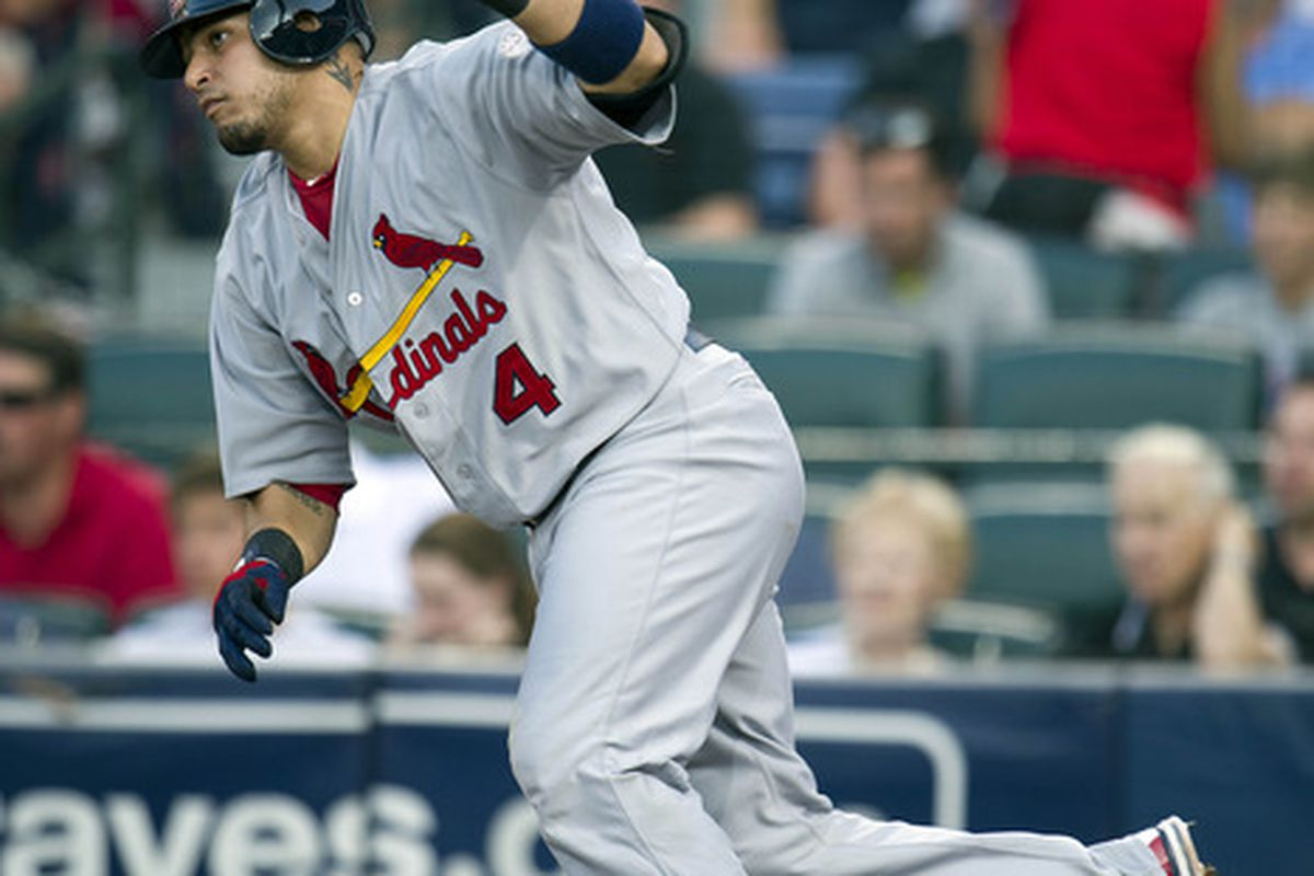 May 29, 2012; Atlanta, GA, USA; St. Louis Cardinals catcher Yadier Molina (4) singles to left field during the 2nd inning off Atlanta Braves starting pitcher Randall Delgado (not pictured) at Turner Field. Mandatory Credit: Paul Abell-US PRESSWIRE
